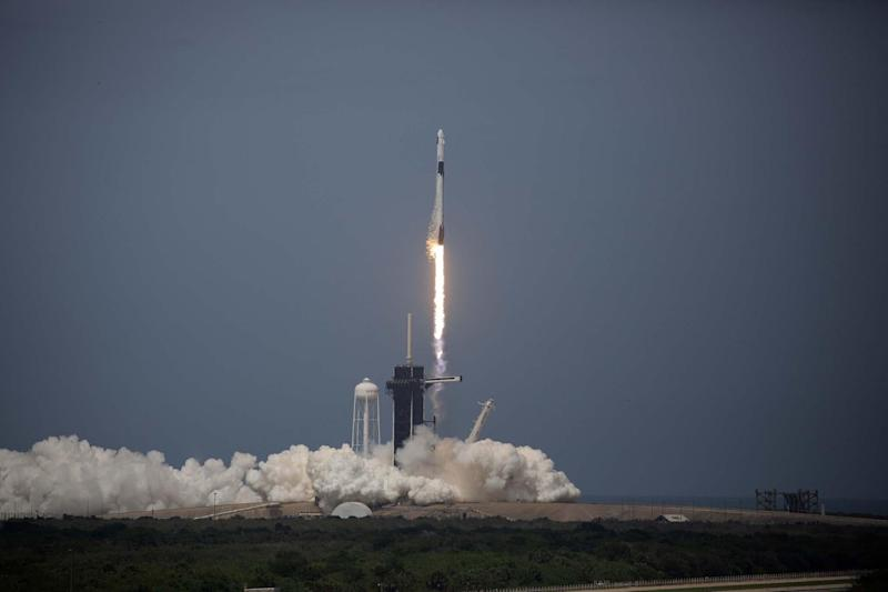 The SpaceX Falcon 9 rocket launches into space with NASA astronauts Bob Behnken (R) and Doug Hurley aboard the rocket from the Kennedy Space Center on May 30, 2020 in Cape Canaveral, Florida: Saul Martinez/Getty Images