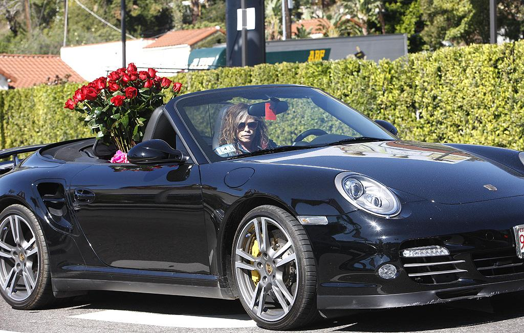 "Steven Tyler's fiancee Erin Brady is one lucky lady! The ""American Idol"" judge was spotted with a huge bouquet of long-stem red roses in the backseat of his Porsche earlier in the day in West Hollywood, California. (2/14/2012)"