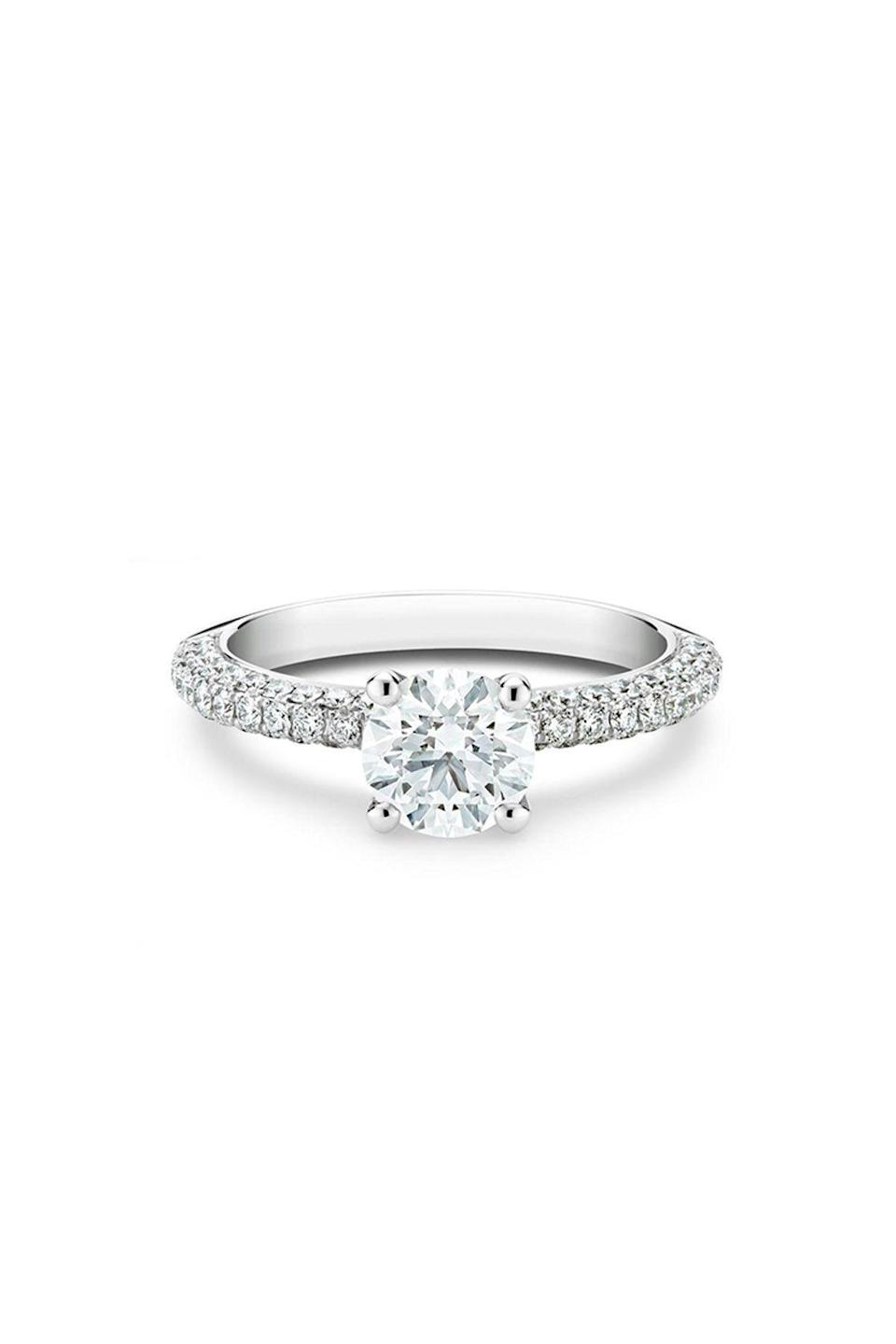 """<p><strong>De Beers</strong></p><p>debeers.com</p><p><strong>$14600.00</strong></p><p><a href=""""https://www.debeers.com/en-us/db-darling-round-brilliant-diamond-ring/R102215.html"""" rel=""""nofollow noopener"""" target=""""_blank"""" data-ylk=""""slk:Shop Now"""" class=""""link rapid-noclick-resp"""">Shop Now</a></p><p>If sweet, simple, and to the point is your preferred style, then a solitaire with a diamond half band is the way to go. It will sit comfortably on your finger while complementing your future wedding band.</p>"""