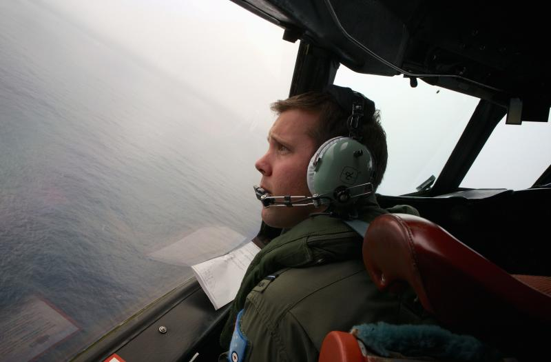 Co-Pilot, Flying Officer Marc Smith, turns his RAAF AP-3C Orion aircraft at low level in bad weather whilst searching for the missing Malaysian Airlines Flight MH370 over the southern Indian Ocean