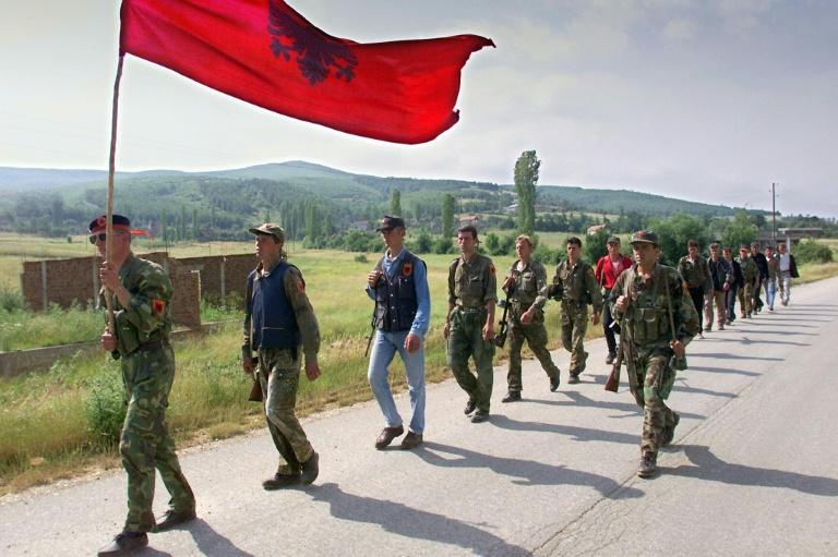 Kosovo Liberation Army fighters marching down the mountains towards Kosovan city Lapusnik in 1999