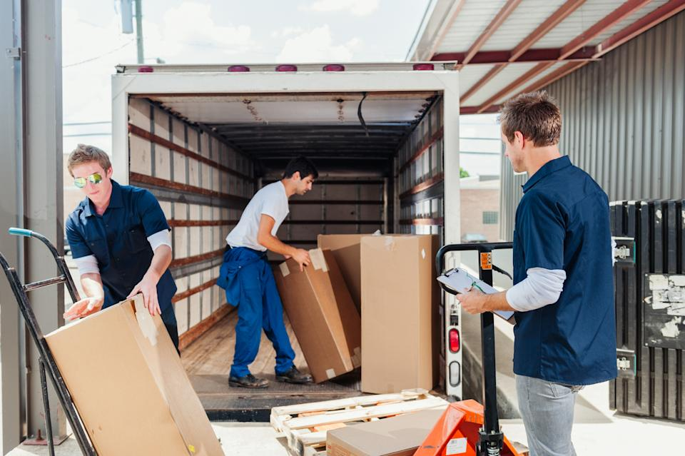 Workers loading a delivery truck.