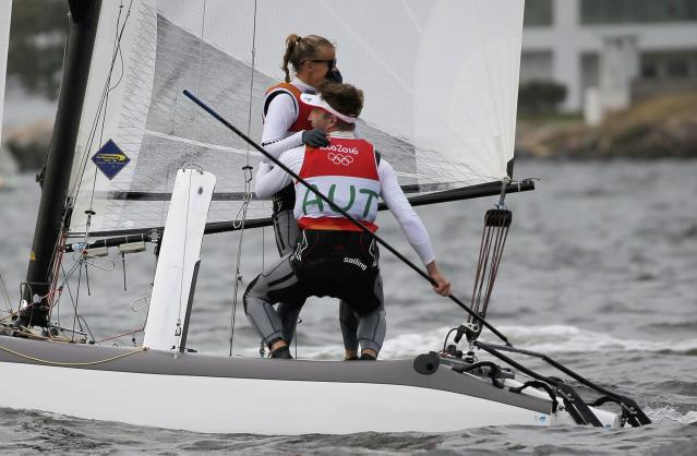 2016 Rio Olympics - Sailing - Final - Mixed Multihull - Nacra 17 - Medal Race - Marina de Gloria - Rio de Janeiro, Brazil - 16/08/2016. Thomas Zajac (AUT) of Austria and Tanja Frank (AUT) of Austria celebrate winning bronze medal. REUTERS/Brian Snyder FOR EDITORIAL USE ONLY. NOT FOR SALE FOR MARKETING OR ADVERTISING CAMPAIGNS.