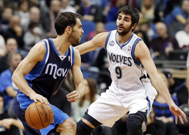 Dallas Mavericks' Jose Calderon, left, of Spain, works his way by Minnesota Timberwolves' Ricky Rubio, of Spain, in the first quarter of an NBA basketball game, Monday, Dec. 30, 2013, in Minneapolis. (AP Photo/Jim Mone)