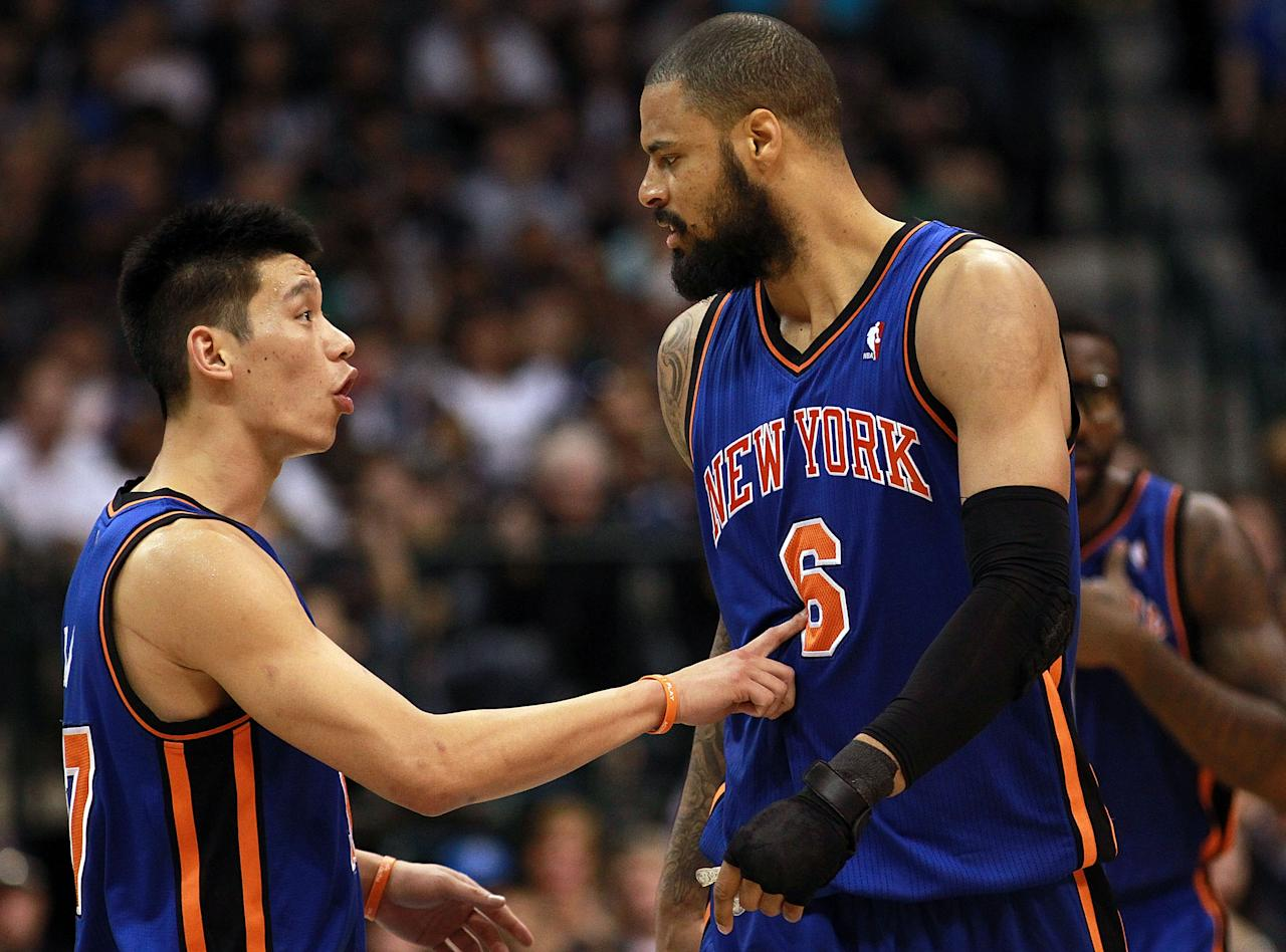 DALLAS, TX - MARCH 06:  Jeremy Lin #17 of the New York Knicks talks with Tyson Chandler #6 during play against the Dallas Mavericks at American Airlines Center on March 6, 2012 in Dallas, Texas.  NOTE TO USER: User expressly acknowledges and agrees that, by downloading and or using this photograph, User is consenting to the terms and conditions of the Getty Images License Agreement.  (Photo by Ronald Martinez/Getty Images)