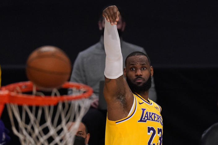 Los Angeles Lakers forward LeBron James shoots during the first half of an NBA basketball game against the Oklahoma City Thunder Monday, Feb. 8, 2021, in Los Angeles. (AP Photo/Mark J. Terrill)