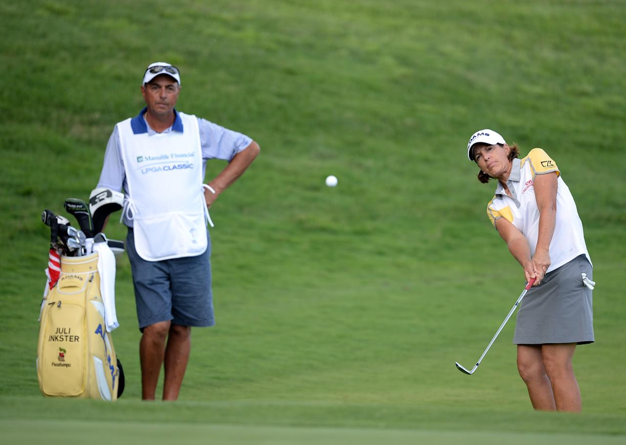 WATERLOO, CANADA - JULY 11: Juli Inkster hits from the rough on the 18th hole during round one of the Manulife Financial LPGA Classic at the Grey Silo Golf Course on July 11, 2013 in Waterloo, Canada. (Photo by Harry How/Getty Images)