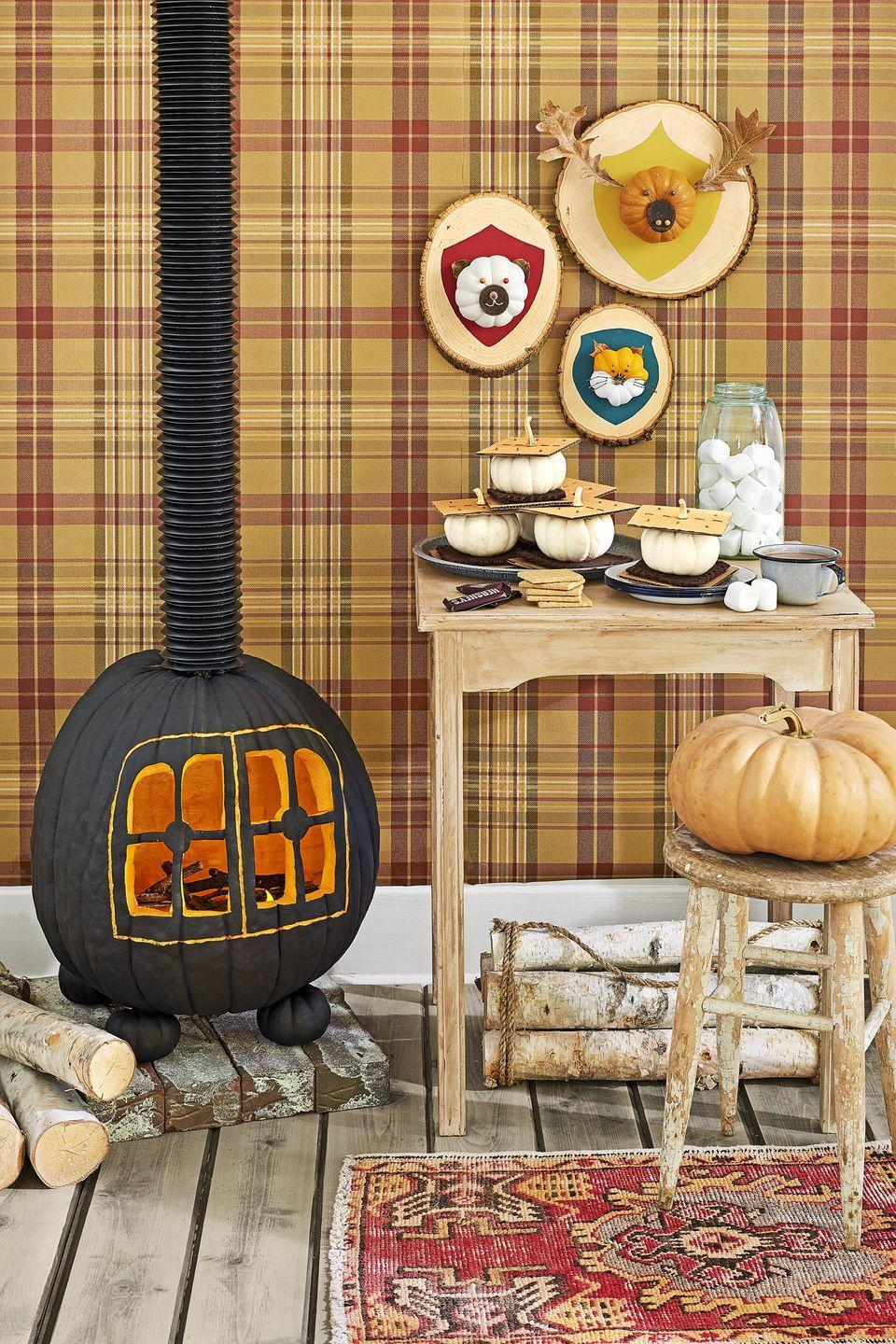 "<p>No cabin evening is complete without a roaring fire. To assemble yours, cut a hole in the bottom of an extra-large pumpkin, and scoop out pulp and seeds. <a href=""https://www.countryliving.com/diy-crafts/how-to/a3048/halloween-templates-1009/"" rel=""nofollow noopener"" target=""_blank"" data-ylk=""slk:Trace the door template"" class=""link rapid-noclick-resp"">Trace the door template</a> on the pumpkin, scaling up or down as necessary. Chisel out the outline, and use a knife to cut out the windowpanes. Paint the pumpkin (excluding chiseled section) black. Fill with sticks longer than the hole, and top with battery-operated tea lights. Remove the stems from four small pumpkins, and paint pumpkins black; place stove pumpkin on top. Rest a piece of solid, <a href=""https://www.amazon.com/dp/B000OHANEM/ref=asc_df_B000OHANEM5142080?tag=syn-yahoo-20&ascsubtag=%5Bartid%7C10050.g.1350%5Bsrc%7Cyahoo-us"" rel=""nofollow noopener"" target=""_blank"" data-ylk=""slk:expandable drain pipe"" class=""link rapid-noclick-resp"">expandable drain pipe</a> over the stem; attach pipe to the wall or ceiling to help it stay upright. </p><p><a class=""link rapid-noclick-resp"" href=""https://www.amazon.com/dp/B01MQ1Q3R1/ref=asc_df_B01MQ1Q3R15142080?tag=syn-yahoo-20&ascsubtag=%5Bartid%7C10050.g.1350%5Bsrc%7Cyahoo-us"" rel=""nofollow noopener"" target=""_blank"" data-ylk=""slk:SHOP TEA LIGHTS"">SHOP TEA LIGHTS</a></p>"