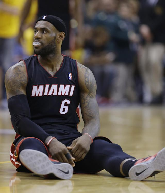 Miami Heat forward LeBron James (6) reacts to being called for a foul against the Indiana Pacers during the second half of Game 5 of the NBA basketball Eastern Conference finals in Indianapolis, Wednesday, May 28, 2014. (AP Photo/Michael Conroy)