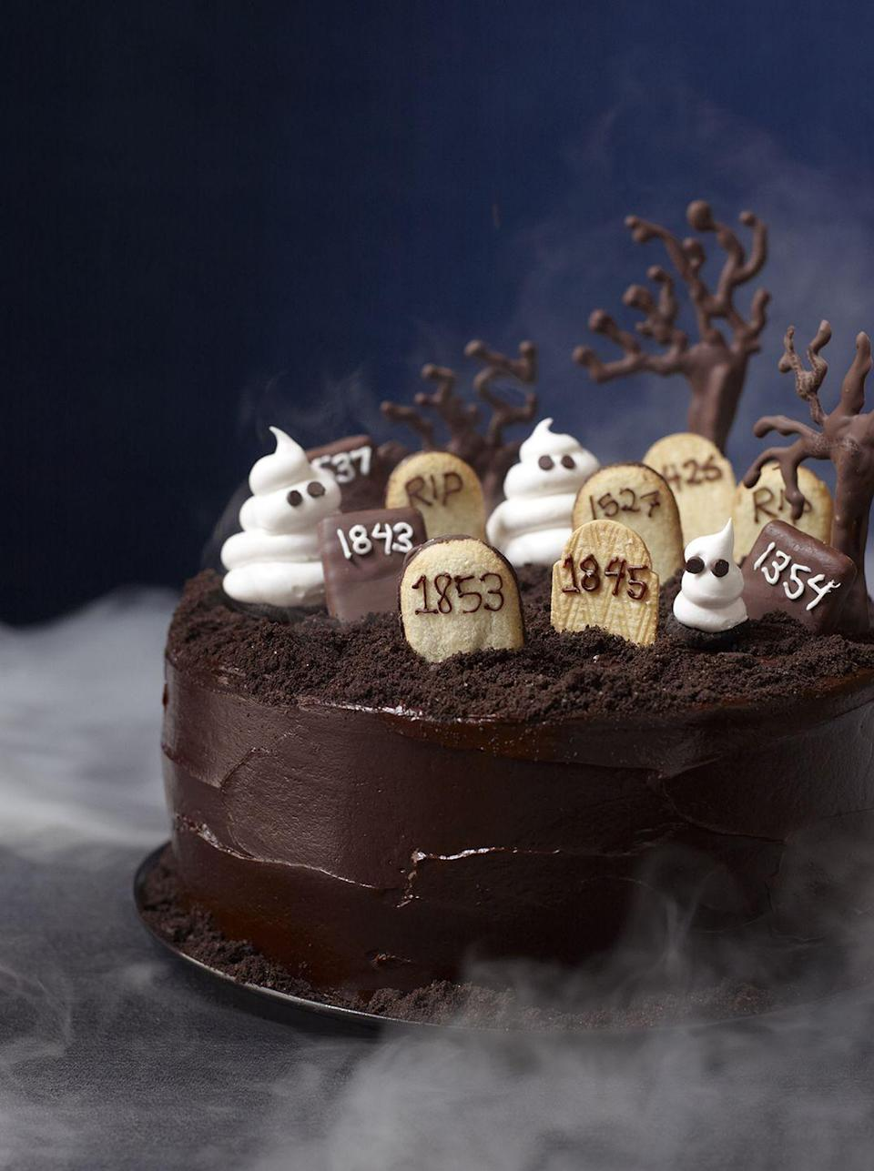 """<p>Espresso-tinged batter and bittersweet chocolate frosting? This cake may look scary but it sure is delicious. </p><p><em><a href=""""https://www.womansday.com/food-recipes/food-drinks/recipes/a11822/graveyard-cake-recipe-123437/"""" rel=""""nofollow noopener"""" target=""""_blank"""" data-ylk=""""slk:Get the Graveyard Cake recipe."""" class=""""link rapid-noclick-resp"""">Get the Graveyard Cake recipe. </a></em></p>"""