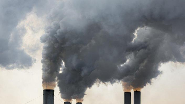 Smoke rises from industrial chimneys in Greece