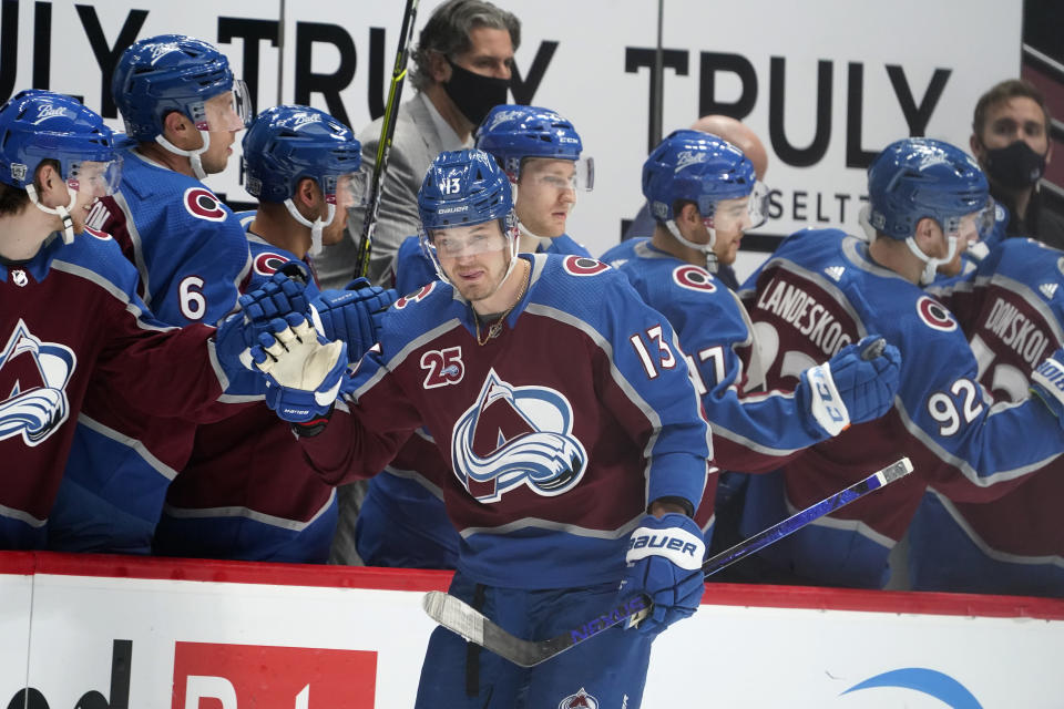 Colorado Avalanche right wing Valeri Nichushkin, front, is congratulated as he passes the team box after scoring a goal against the San Jose Sharks during the second period of an NHL hockey game Tuesday, Jan. 26, 2021, in Denver. (AP Photo/David Zalubowski)