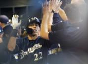 Milwaukee Brewers' Christian Yelich is congratulated after hitting a home run during the ninth inning of a baseball game against the Houston Astros Monday, Sept. 2, 2019, in Milwaukee. (AP Photo/Morry Gash)