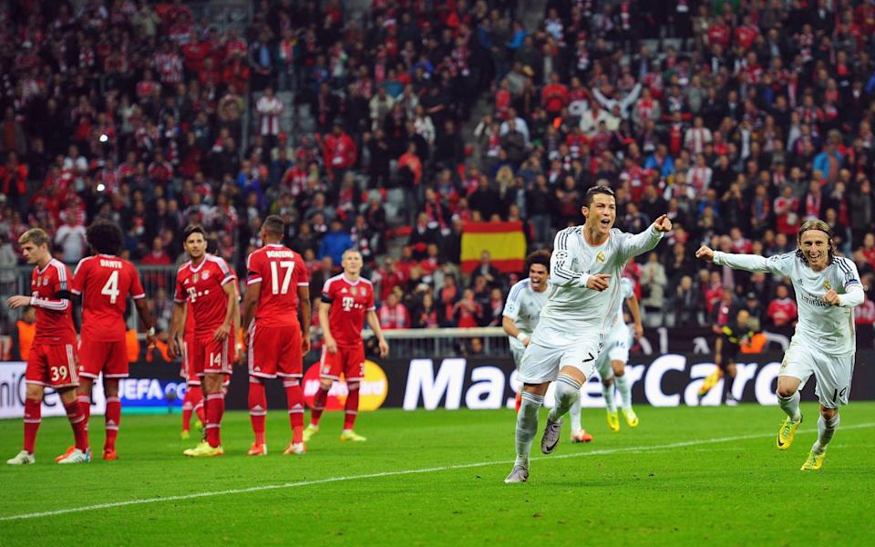 Cristiano Ronaldo of Real Madrid celebrates scoring his second goal during the UEFA Champions League Semi Final second leg match between FC Bayern Muenchen and Real Madrid - GETTY IMAGES