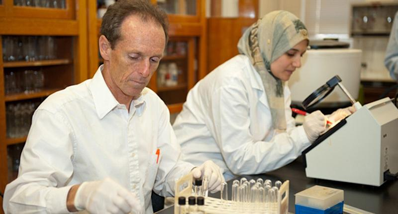 Professor Paul Dawson (left) works in the lab alongside a student. Source: Clemson University
