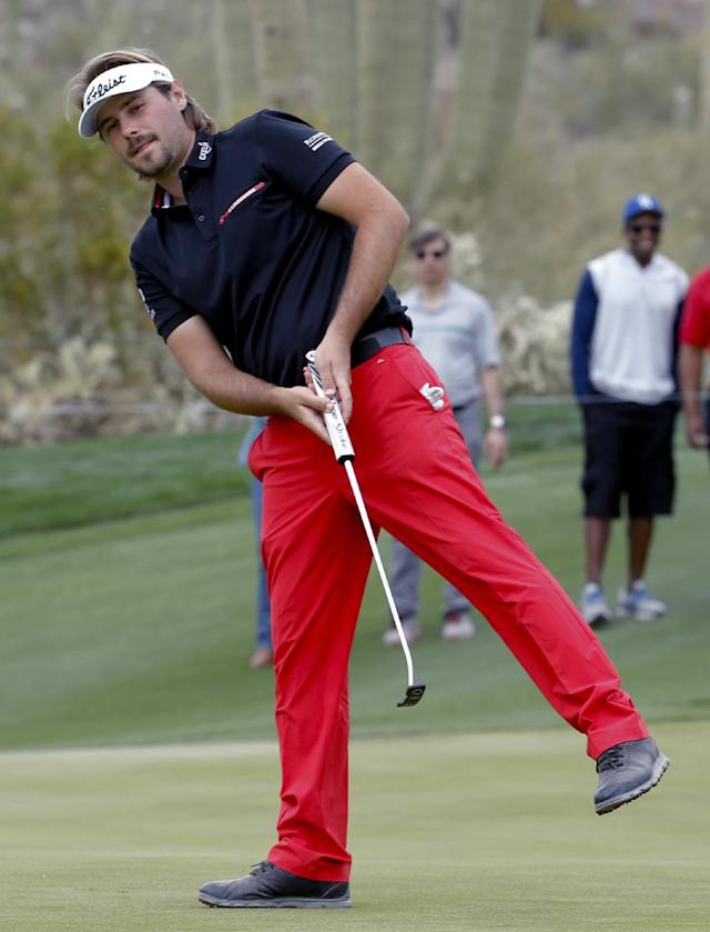 Victor Dubuisson, of France, reacts to his putt on the 16th hole in his championship match against Jason Day, of Australia, during the Match Play Championship golf tournament on Sunday, Feb. 23, 2014, in Marana, Ariz. (AP Photo/Matt York)