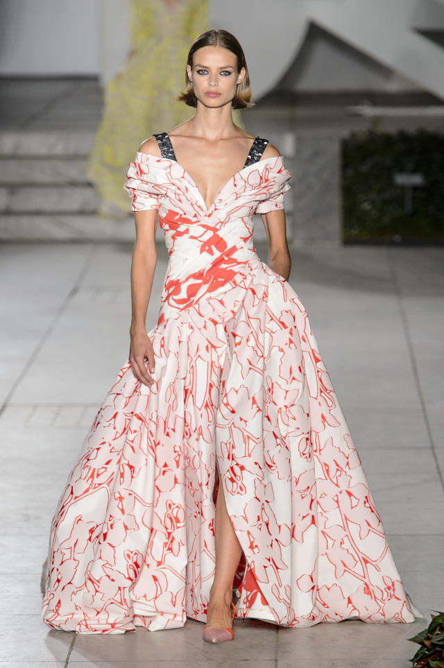 <p><i>Model wears a red-and-white print ball gown from the SS18 Carolina Herrera collection. (Photo: IMAXtree) </i></p>