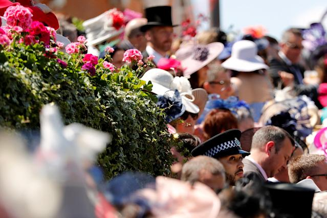 Horse Racing - Royal Ascot - Ascot Racecourse, Ascot, Britain - June 21, 2018 A police officer looks on as racegoers gather for the start of the racing Action Images via Reuters/Andrew Boyers