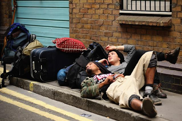 LONDON, ENGLAND - JUNE 11: Protesters relax after being led from a building they had been occupying on Beak Street in Soho, as part of a protest ahead of next week's G8 summit in Northern Ireland on June 11, 2013 in London, England. Next week will see Enniskillen in Northern Ireland host the two day G8 summit where international leaders including Britain's Prime Minister David Cameron and US President Barack Obama take part in the two day event. The chosen location is only 8 kilometers from the scene of one of Northern Ireland's worst killings back in 1987, however Cameron is confident that it's secluded location will deter any potential trouble. (Photo by Dan Kitwood/Getty Images)