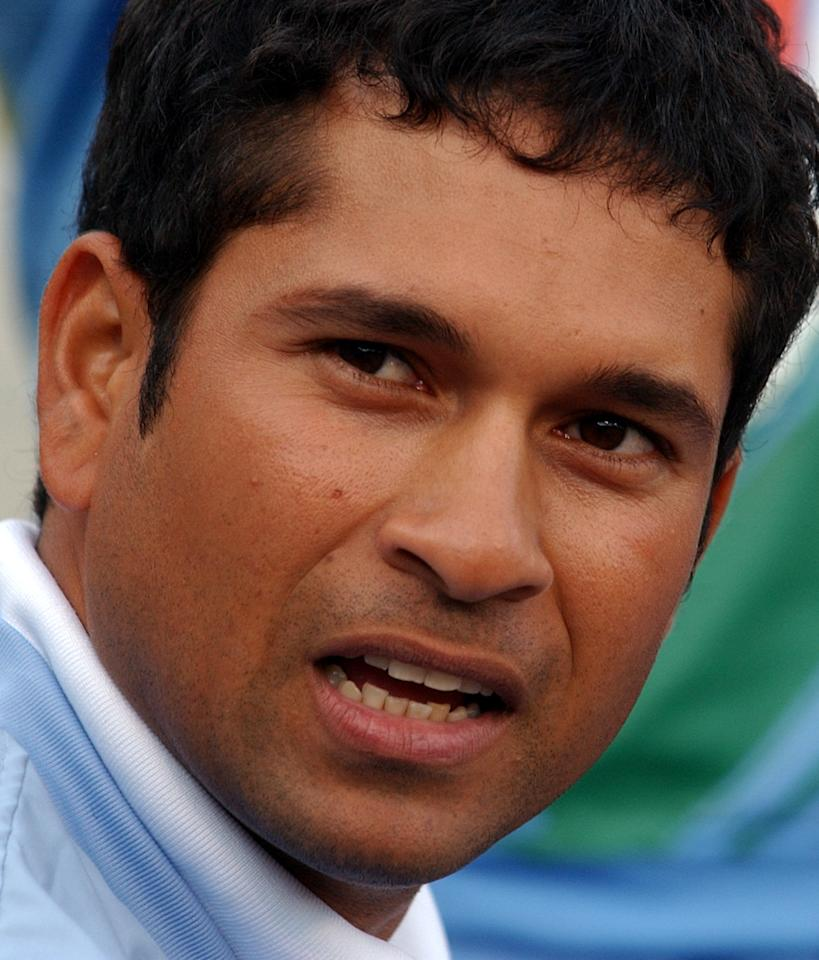 AUCKLAND, NEW ZEALAND - DECEMBER 26:  Injured Indian Sachin Tendulkar watches the first of the one day cricket matchs against the New Zealand Black Caps at Eden Park, Auckland, Thursday 26 December, 2002.  (Photo by Ross Setford/Getty Images)