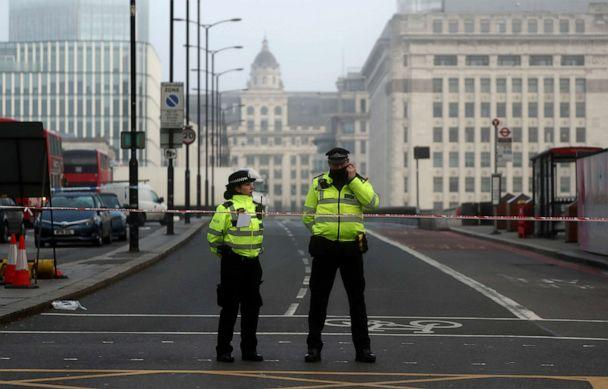PHOTO: Police officers stand behind the cordon at the scene of a stabbing near London Bridge, in which two people were killed, in London, England, November 30, 2019. (Simon Dawson/Reuters)