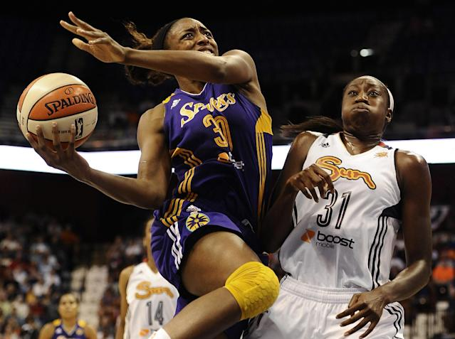 Los Angeles Sparks' Nneka Ogwumike, left, drives to the basket while guarded by Connecticut Sun's Tina Charles, right, during the second half of a WNBA basketball game in Uncasville, Conn., Tuesday, Aug. 6, 2013. The Sparks won 74-72. (AP Photo/Jessica Hill)