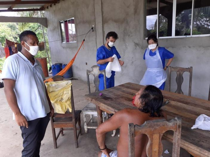 In this photo taken Tuesday, May 26, 2020, medial workers take care of residents of the remote village of Camopi, French Guiana. France's most worrisome virus hotspot is in fact on the border with Brazil - in French Guiana, a former colony where health care is scarce and poverty is rampant. The pandemic is exposing deep economic and racial inequality in French Guiana that residents say the mainland has long chosen to ignore. (AP Photo)