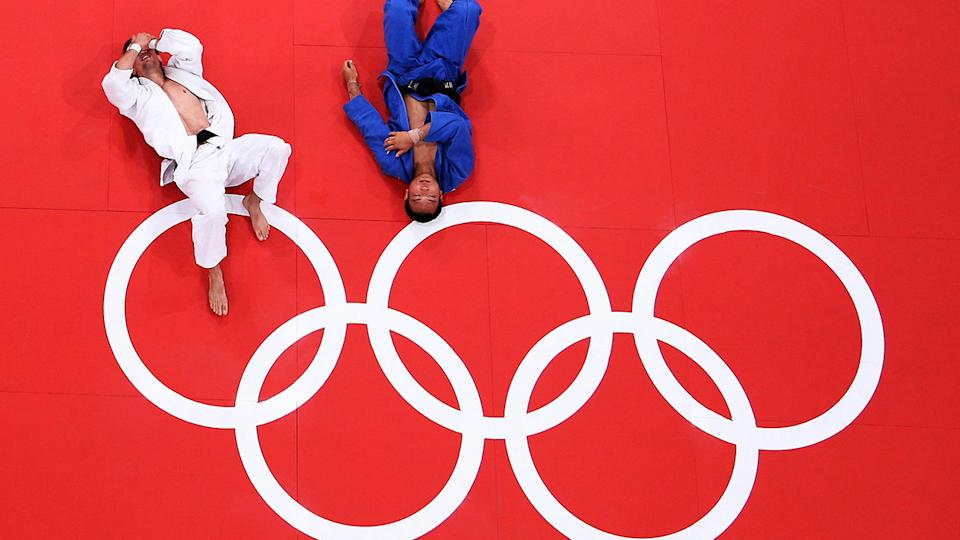Two athletes, pictured here competing in judo at the London 2012 Olympic Games.