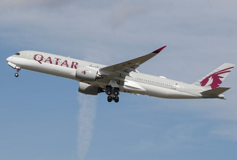 FILE PHOTO: A Qatar Airways aircraft takes off at the aircraft builder's headquarters of Airbus in Colomiers near Toulouse