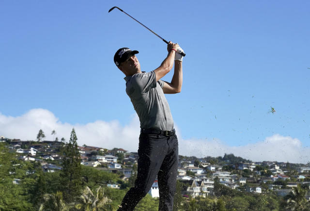 Justin Thomas hits from the 16th fairway during the second round of the Sony Open PGA Tour golf event, Friday, Jan. 11, 2019, at Waialae Country Club in Honolulu. (AP Photo/Matt York)