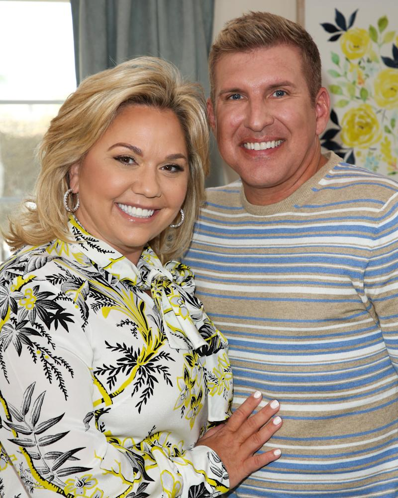 "UNIVERSAL CITY, CA - JUNE 18: Reality TV Personalities Julie Chrisley (L) and Todd Chrisley (R) visit Hallmark's ""Home & Family"" at Universal Studios Hollywood on June 18, 2018 in Universal City, California. (Photo by Paul Archuleta/Getty Images)"