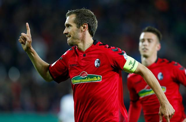Soccer Football - DFB Cup Second Round - SC Freiburg v Dynamo Dresden - Dreisamstadion, Freiburg, Germany - October 25, 2017 SC Freiburg's Julian Schuster celebrates scoring their second goal REUTERS/Ralph Orlowski DFB RULES PROHIBIT USE IN MMS SERVICES VIA HANDHELD DEVICES UNTIL TWO HOURS AFTER A MATCH AND ANY USAGE ON INTERNET OR ONLINE MEDIA SIMULATING VIDEO FOOTAGE DURING THE MATCH.