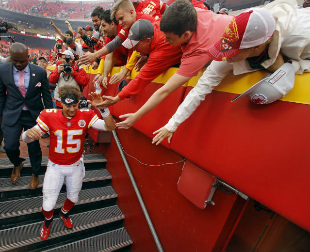 Kansas City Chiefs quarterback Patrick Mahomes (15) greets fans after an NFL football game against the Jacksonville Jaguars, Sunday, Oct. 7, 2018, in Kansas City, Mo. (AP Photo/Charlie Riedel)