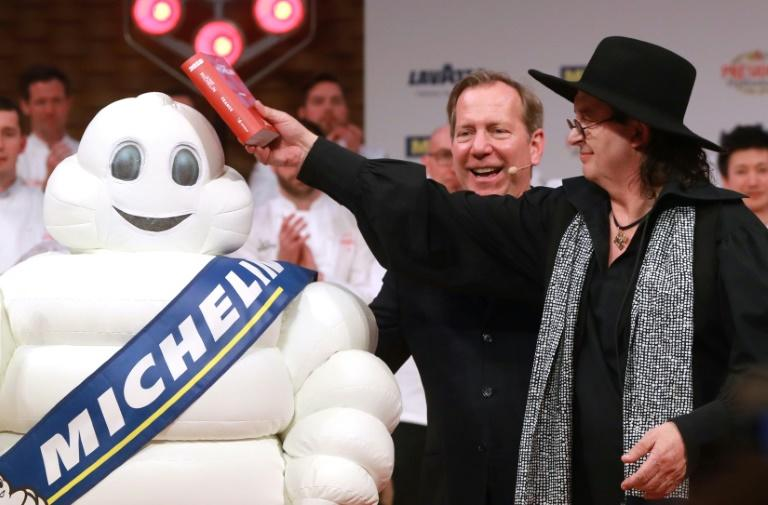Chef Marc Veyrat, seen celebrating after winning three Michelin stars in 2018, lost one the following year and sued the guide for suggesting, wrongly, he insists, he had used cheddar cheese in a souffle
