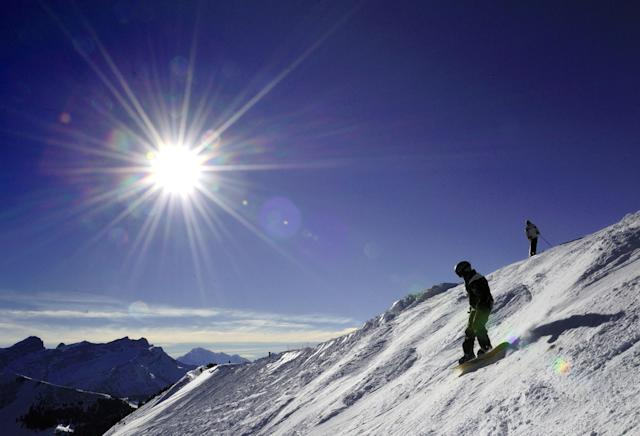 Skiers and snowboarders enjoy fresh snow and bright sun on the slopes near Diablerets (AFP Photo/Fabrice Coffrini)