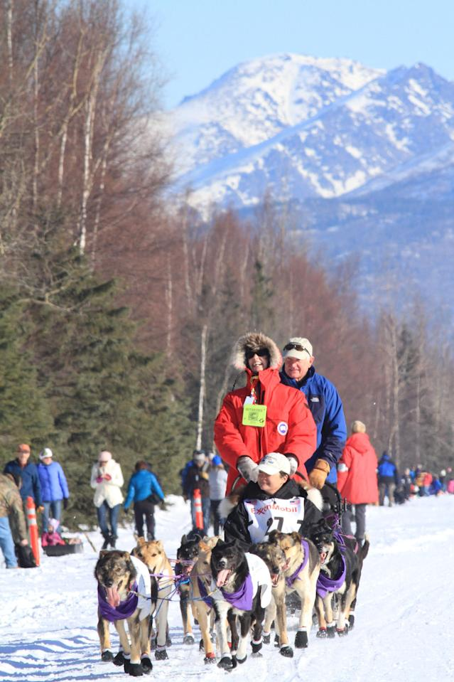 Musher Jessie Royer of Darby, Mt., drivers her dog team along Campbell Air Strip near the end of the ceremonial start of the 2014 Iditarod Trail Sled Dog Race on Saturday, March 1, 2014, in Anchorage, Alaska. (AP Photo/Dan Joling)