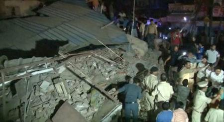 Policemen and locals gather at the site after a four-story hotel collapsed in a crowded part of the central Indian city of Indore late on Saturday, in this still image taken from video released on April 1, 2018. ANI/via REUTERS TV