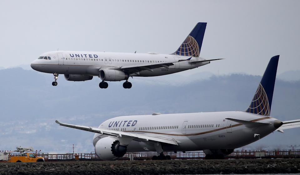 BURLINGAME, CALIFORNIA - MARCH 06: A United Airlines plane lands at San Francisco International Airport on March 06, 2020 in Burlingame, California. In the wake of the COVID-19 outbreak, airlines are facing significant losses as people are cancelling travel plans and businesses are restricting travel. Southwest Airlines says they expect to lose between $200 to $300 million dollars in the coming weeks. Other airlines like United and Jet Blue are cutting flights. The International Air Transport Association predicts that carriers could lose between $63 billion and $113 billion this year. (Photo by Justin Sullivan/Getty Images)