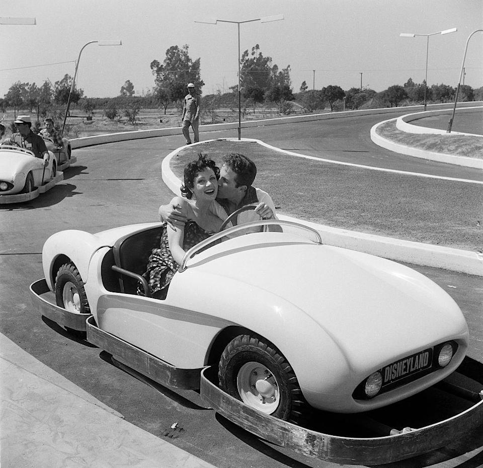 "<p>Actors Steve Rowland and Kathleen Case pose as they ride on Autopia during the opening day of Disneyland.</p><p>Other celebrity visitors this year:<span class=""redactor-invisible-space""> actress Adelle August, Ronald Reagan and (of course) Walt Disney.<br></span></p>"