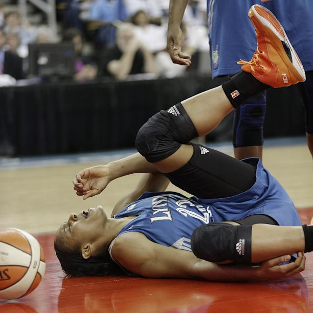 Minnesota Lynx' Maya Moore (23) hits the floor after being fouled during the first half of Game 3 of the WNBA Finals basketball game against the Atlanta Dream, in Duluth, Ga., Thursday, Oct. 10, 2013. (AP Photo/John Bazemore)