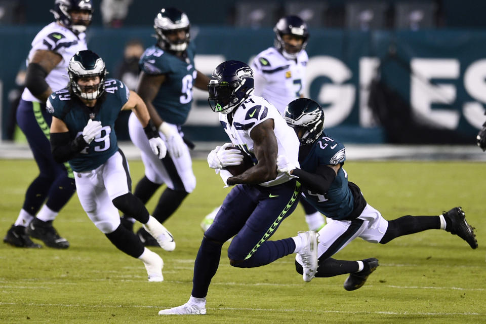 Seattle Seahawks' DK Metcalf, left, is tackled by Philadelphia Eagles' Darius Slay during the first half of an NFL football game, Monday, Nov. 30, 2020, in Philadelphia. (AP Photo/Derik Hamilton)