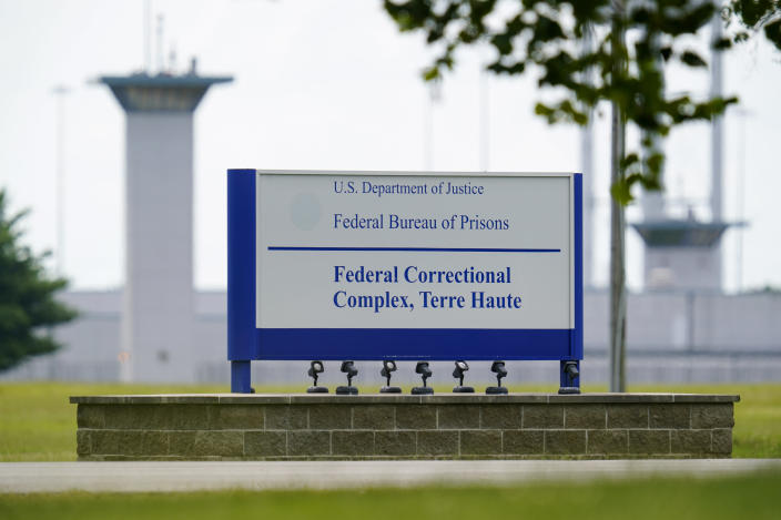 FILE - This Aug. 28, 2020, file photo shows the federal prison complex in Terre Haute, Ind. Two journalists tested positive for coronavirus after witnessing the Trump administration's final three federal executions, but the Bureau of Prisons knowingly withheld the diagnoses from other media witnesses and did not perform any contact tracing. (AP Photo/Michael Conroy, File)