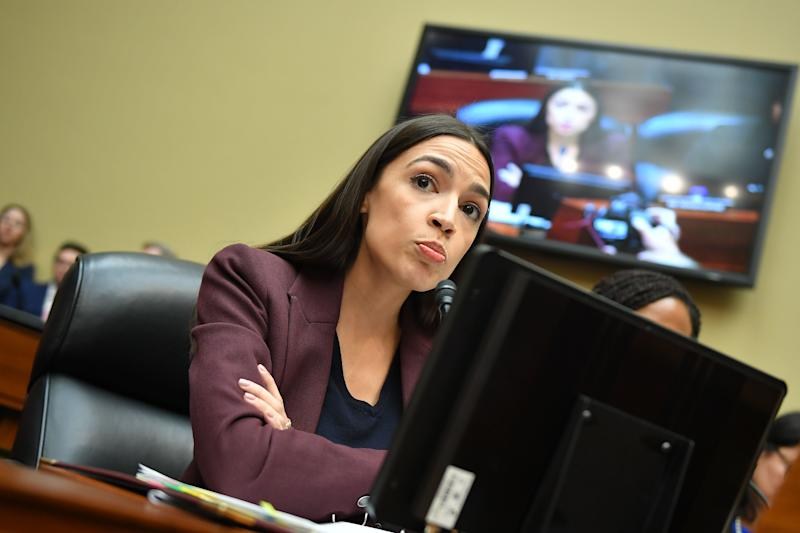 US Congresswoman Alexandria Ocasio-Cortez, Democrat of New York, questions Michael Cohen, US President Donald Trump's former personal attorney, as he testifies before the House Oversight and Reform Committee. (Photo by Mandel Ngan/AFP/Getty Images)