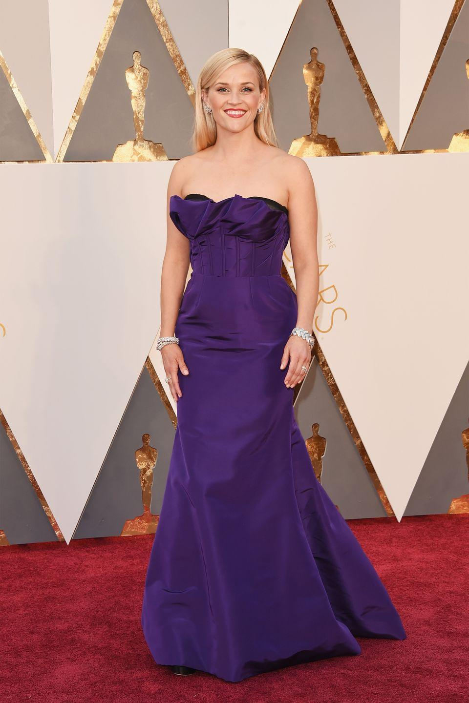 <p>Witherspoon clearly has a penchant for the color purple, she wore this Oscar de la Renta number as</p>