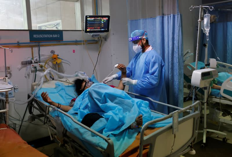 Patient suffering from COVID-19 is treated at Safdarjung Hospital in New Delhi