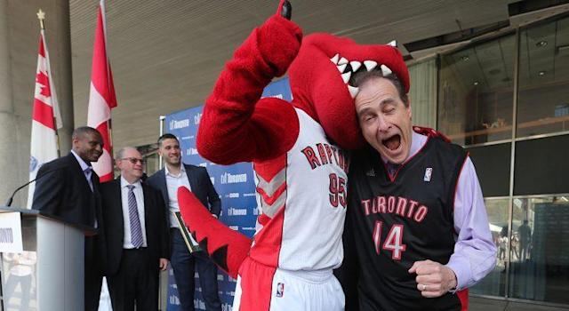 Toronto councilor Norm Kelly has a little fun with the Raptor. (Getty Images)