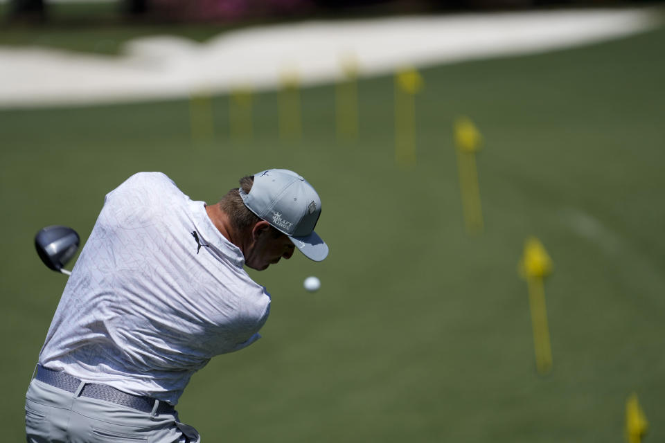 Bryson DeChambeau warms up on the range before a practice round for the Masters golf tournament on Monday, April 5, 2021, in Augusta, Ga. (AP Photo/David J. Phillip)