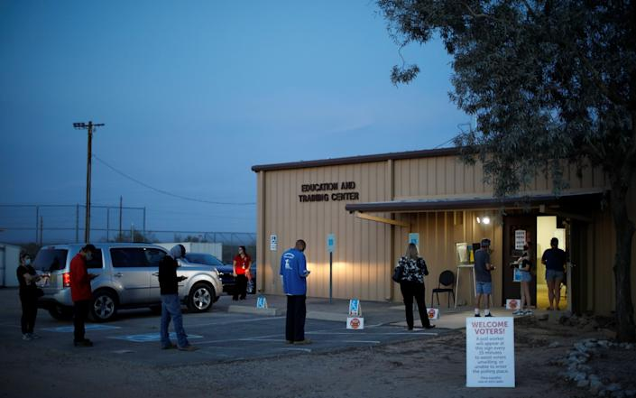 The last few voters trickle through the doors at a polling station in Marana, Arizona - REUTERS