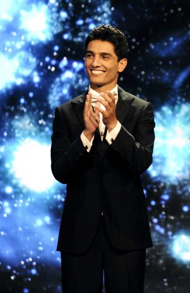 In this Saturday, June 22, 2013 photo released by the MBC Group, singer Mohammed Assaf is seen on the Arab Idol stage in Beirut, Lebanon. On Saturday night, Assaf became the first Palestinian to win the Arab world's version of American Idol, setting off wild celebrations across the Palestinian territories. After the victory, Palestinian President Mahmoud Abbas declared the singer an honorary ambassador. (AP Photo/MBC Group)