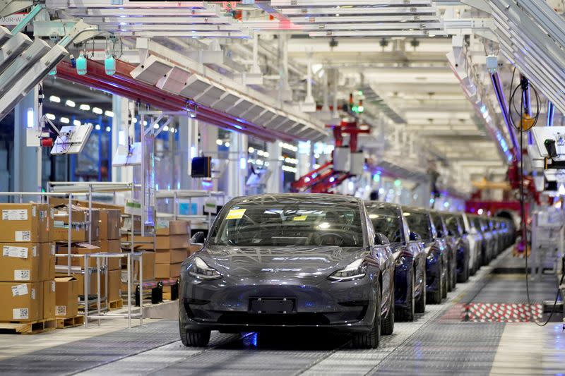 FILE PHOTO: FILE PHOTO: Tesla China-made Model 3 vehicles are seen during a delivery event at its factory in Shanghai